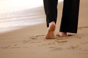 Woman walking on the sandbeach